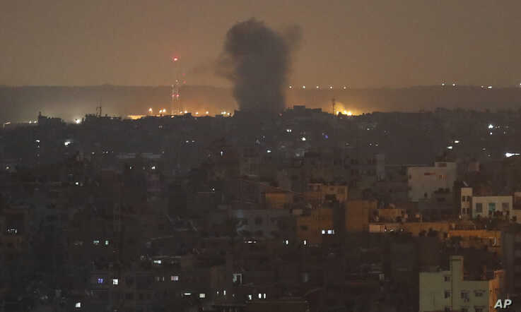 An explosion caused by Israeli airstrikes is seen in Gaza City, early Thursday, Nov. 14, 2019. Israeli aircraft struck Islamic…