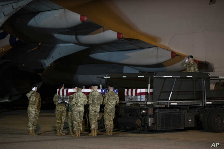 A U.S. Army carry team moves a transfer case containing the remains of Chief Warrant Officer 2 David C. Knadle, of Tarrant,…