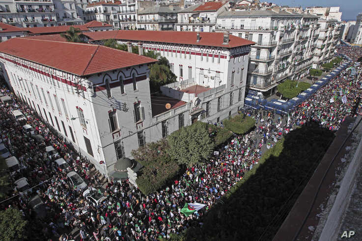 Algerian demonstrators take to the streets in the capital Algiers to protest against the government, in Algeria, Friday, Nov. 1…