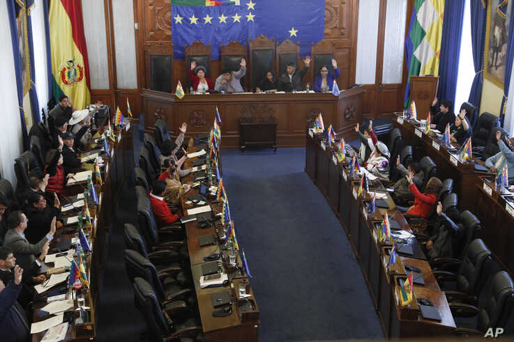 Senators approve a bill on holding new elections in La Paz, Bolivia, Saturday, Nov. 23, 2019. Bolivia is struggling to…