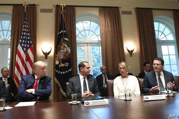 President Donald Trump, second from left, listens to American Vaping Association President Greg Conley, right, during a meeting…