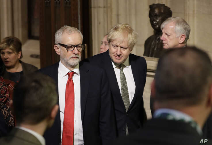 Britain's Prime Minister Boris Johnson, centre right and opposition Labour Party Leader Jeremy Corbyn, walk through the Commons…