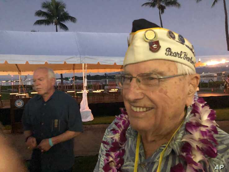 Herb Elfring, 97, of Jackson, Mich. attends the ceremonies at Pearl Harbor, Hawaii on Saturday, Dec. 7, 2019. Elfring survived…