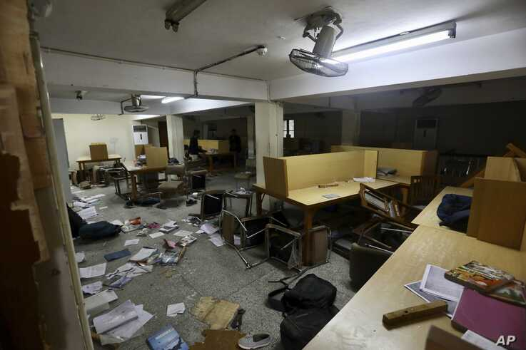 The library of the Jamia Millia Islamia University that was stormed by police Sunday in New Delhi, India, Monday, Dec.16, 2019…