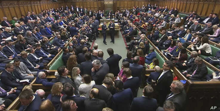 Lawmakers await the result of the vote on The European Union (Withdrawal Agreement) Bill in the House of Commons in London,…
