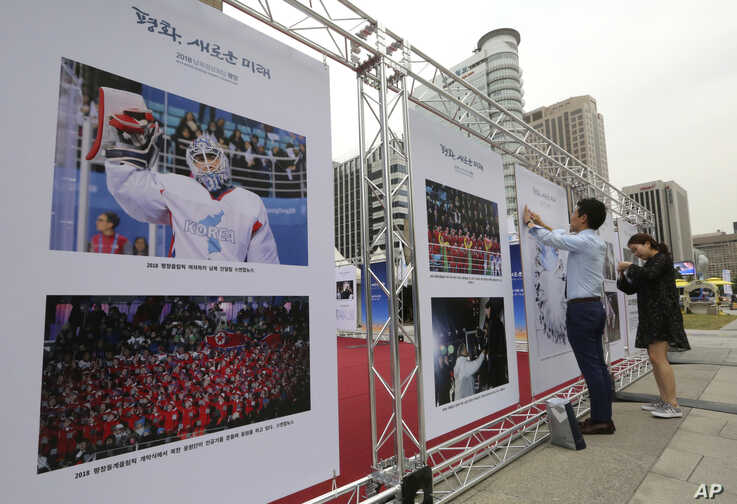 Photos of the 2018 Pyeongchang Winter Olympics are displayed during a photo exhibition to wish for peace on the Korean…