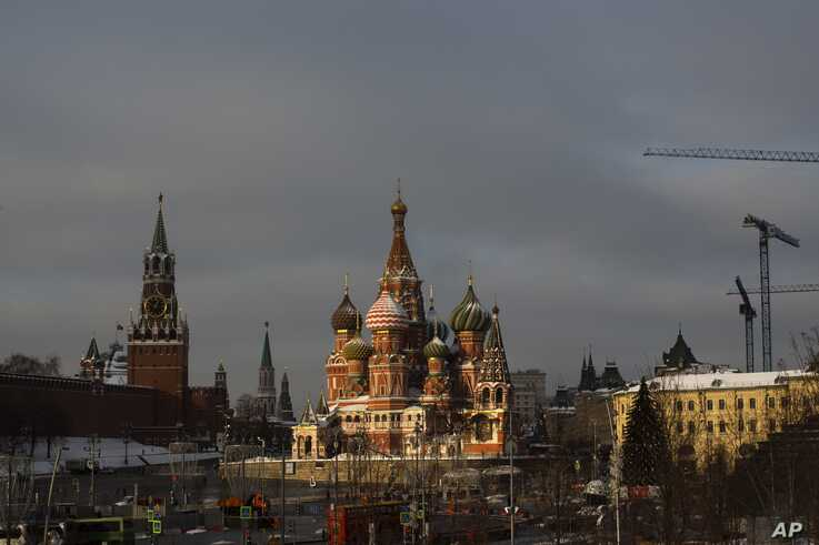 In this photo taken on Friday, Jan. 11, 2019, a sun ray illuminates St. Basil's Cathedral on Red Square during a cold winter…
