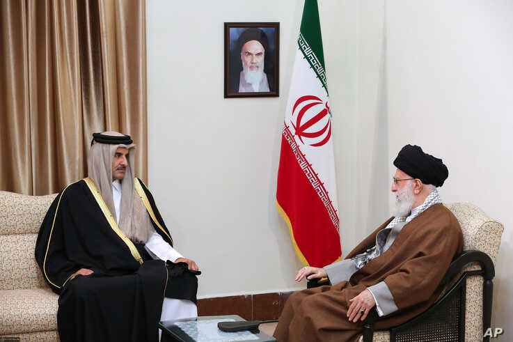In this photo released by an official website of the office of the Iranian supreme leader, Supreme Leader Ayatollah Ali…
