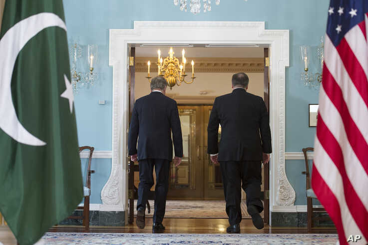 Secretary of State Mike Pompeo, right, meets Pakistani Foreign Minister Makhdoom Shah Mahmood Qureshi at the State Department…