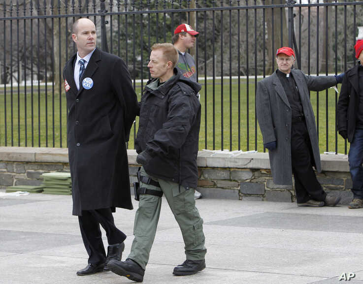 Sierra Club Executive Director Michael Brune is arrested outside the White House in Washington, Wednesday, Feb. 13, 2013, as…