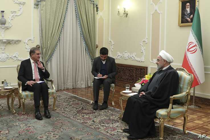 FILE - In this Sunday, Jan. 12, 2020 file photo, released by official website of the Office of the Iranian Presidency, Pakistan…