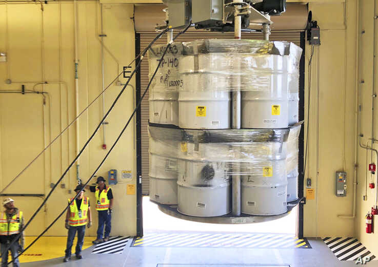 FILE - Barrels of radioactive waste are loaded for transport to the Waste Isolation Pilot Plant, at the Radioactive Assay Nondestructive Testing (RANT) facility in Los Alamos, N.M., April 9, 2019.