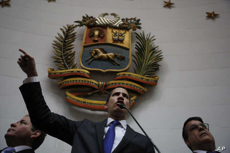 Opposition leader Juan Guaido speaks at the National Assembly in Caracas, Venezuela, Tuesday, Jan. 7, 2020. Guaidó and…