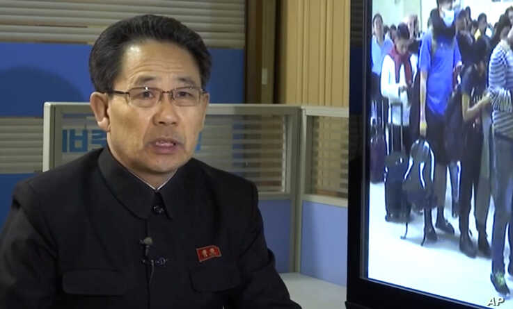 In this image made from video, North Korea's Ministry of Health Director Kim Dong Gun talks about the country's efforts to…