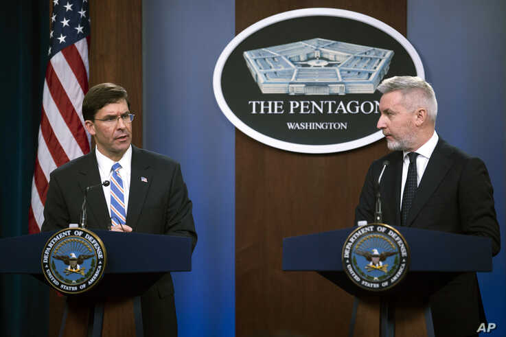 Secretary of Defense Mark Esper, left, and Italian Minister of Defense Lorenzo Guerini take part in a joint press conference on…