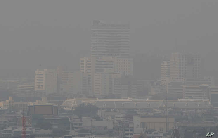 A thick layer of smog covers central Bangkok, Thailand, Monday, Jan. 20, 2020. Thick haze blanketed the Thai capital on Monday…