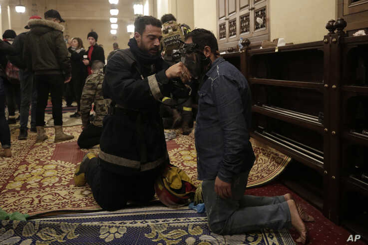 An anti-government protester receives treatment after confrontation with Lebanese riot police inside the Mohammad al-Amin…