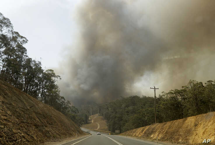 Smoke from a fire at Batemans Bay, Australia, billows into the air, Saturday, Jan. 4, 2020. Australia's prime minister called…