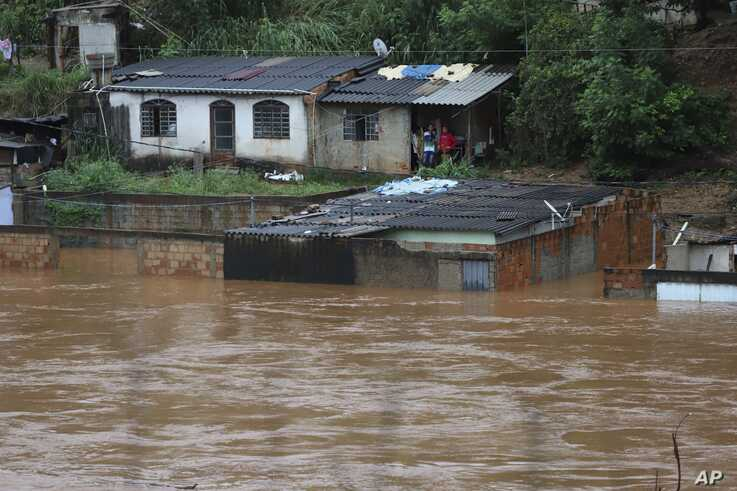 A view of flooded houses caused by heavy rains in Sabara municipality, Minas Gerais state, Brazil, Friday, Jan.24, 2020. Heavy…