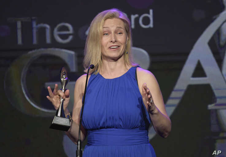 """Mary Louise Kelly accepts the award for best reporter/correspondent/host - non-commercial for """"All Things Considered"""" on """"NPR…"""
