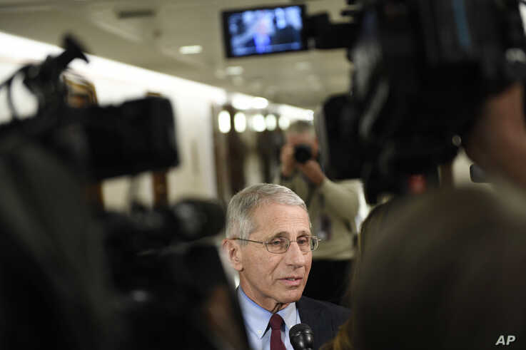 Dr. Anthony Fauci, head of the National Institute of Allergy and Infectious Diseases, talks to reporters before the start of a…