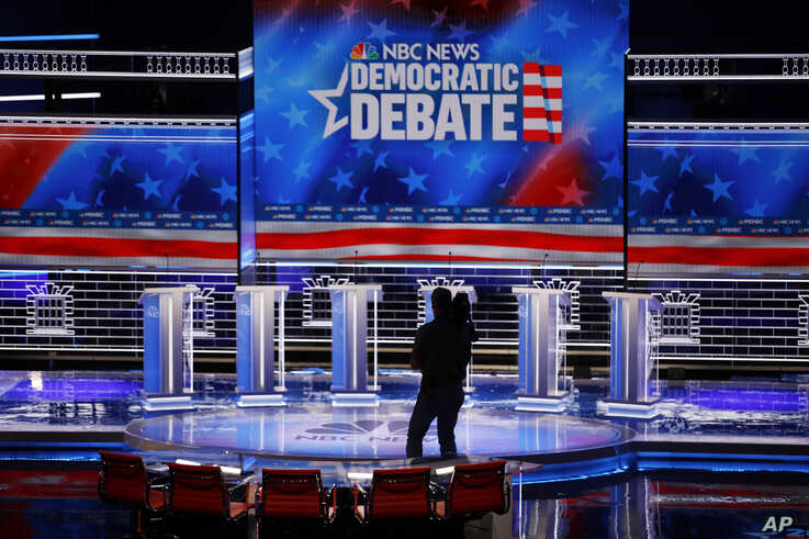 A cameraman walks across the stage during setup for the Nevada Democratic presidential debate Tuesday, Feb. 18, 2020, in Las…