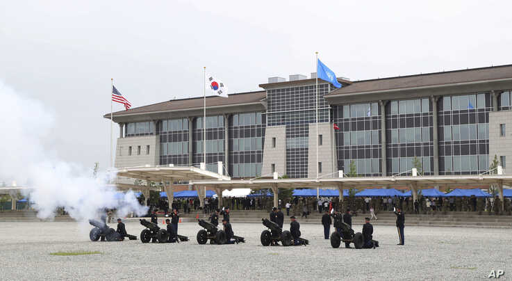 U.S. Army soldiers fire cannons during an opening ceremony for the new headquarters of the U.S. Forces Korea (USFK) at Camp…
