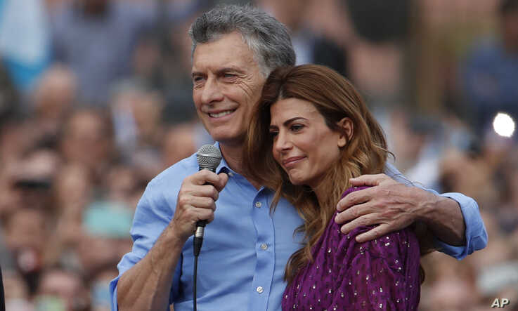 Argentina's President Mauricio Macri and his wife Juliana Awada react during a rally in support of Macri, in Buenos Aires,…