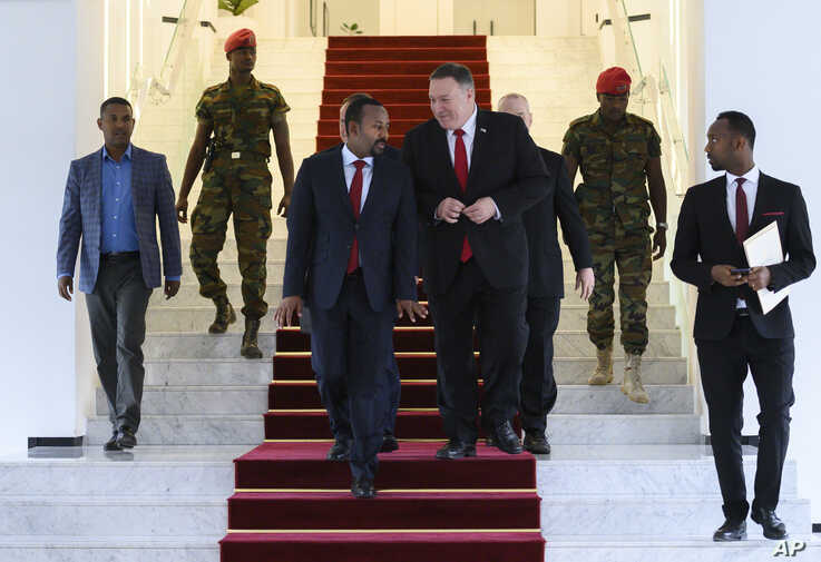 US Secretary of State Mike Pompeo, center right, walks with Ethiopian Prime Minister Abiy Ahmed at the Prime Minister's office…