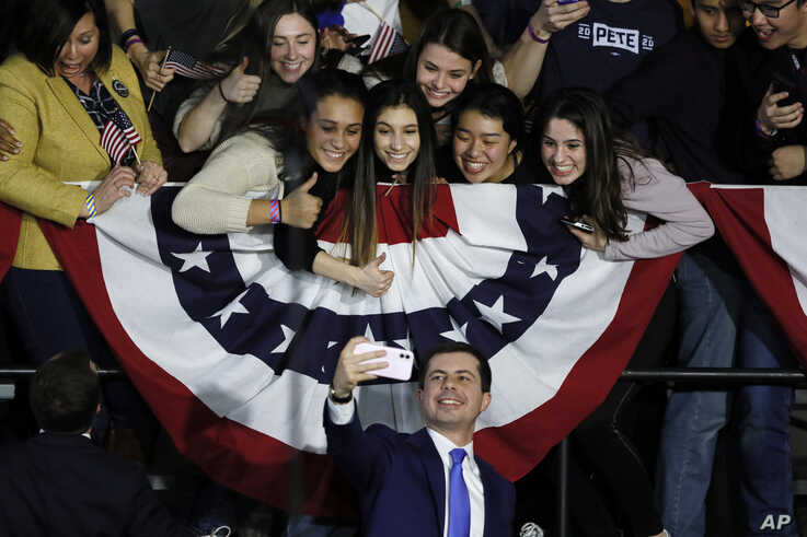 Democratic presidential candidate former South Bend, Ind., Mayor Pete Buttigieg takes a selfie with supporters after speaking…