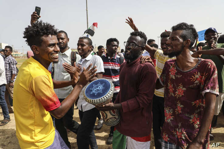 People take part in a protest condemning a deadly crackdown last month in Khartoum, Sudan, Thursday, July 18, 2019. Thousands…