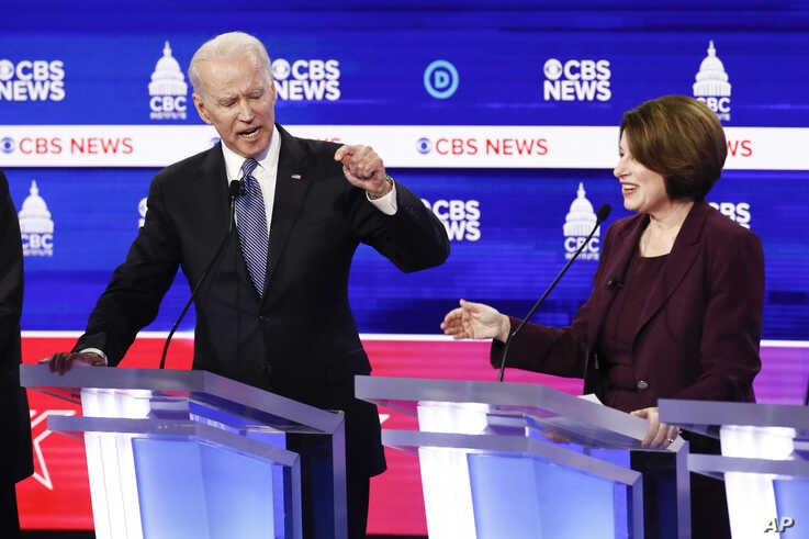 Democratic presidential candidates, former Vice President Joe Biden, left, and Sen. Amy Klobuchar, D-Minn., participate in a Democratic presidential primary debate at the Gaillard Center, Tuesday, Feb. 25, 2020, in Charleston, S.C.