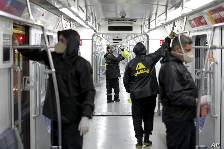 Workers disinfect subway trains against coronavirus in Tehran, Iran, in the early morning of Wednesday, Feb. 26, 2020. Iran's…