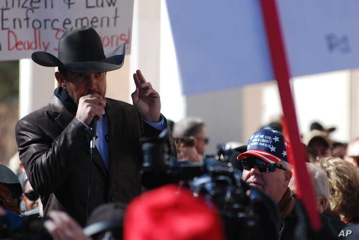 Otero County Commissioner Couy Griffin speaks Friday, Jan. 31, 2020, in Santa Fe, N.M., as hundreds of advocates for gun rights…
