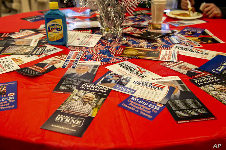US Senate fliers for th Alabama seat rest on tabletops at a Jefferson County GOP candidate pancake breakfast, Saturday, Feb. 29…
