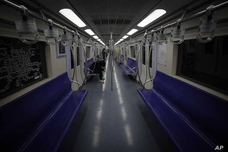 Few commuters ride in an almost empty subway train in Beijing, Monday, Feb. 24, 2020. Regulators on promised tax cuts and other…