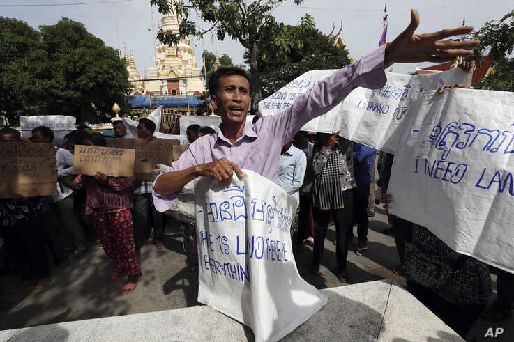 A land eviction protester shouts slogans during a protest rally near prime minister's residence in Phnom Penh, Cambodia, Monday…