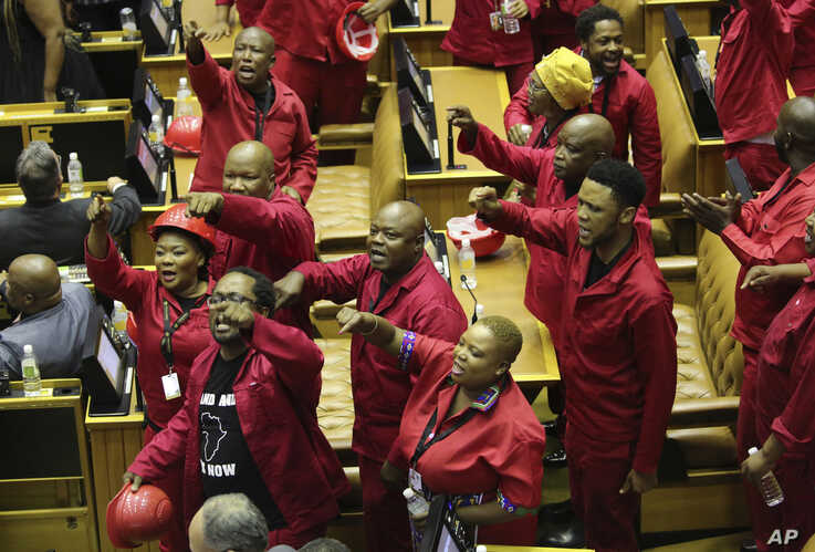Members of the Economic Freedom Fighters (EFF) party disrupt parliament proceedings at the State of the Nation Address in Cape Town, South Africa, Feb. 13, 2020.