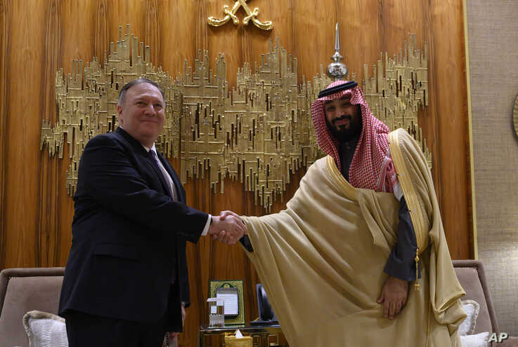 U.S. Secretary of State Mike Pompeo, left, shakes hands with Saudi Arabia's Crown Prince Mohammed bin Salman at Irqah Palace,…