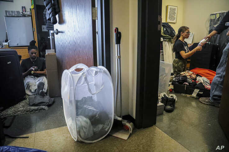 Princeton University students Halima Matthews, 20, left, and best friend Deztynee Rivera, 20, right, pack their rooms to leave…