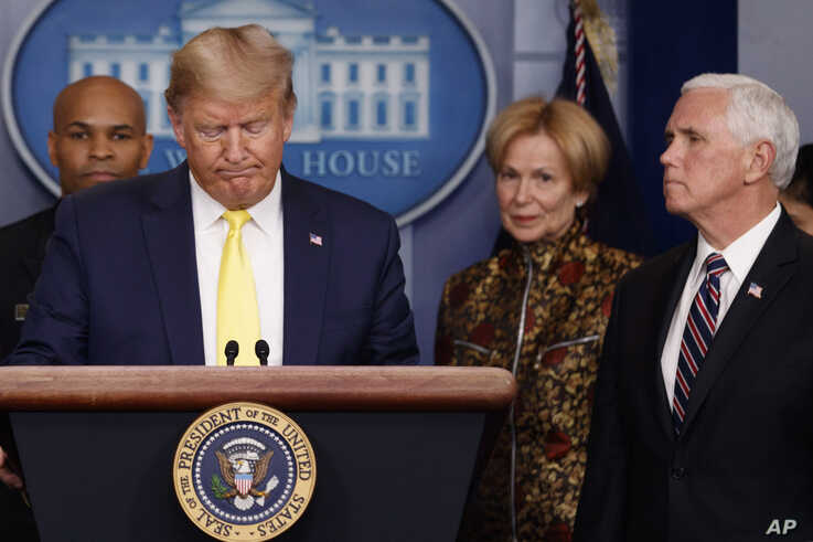 President Donald Trump pauses as he speaks in the briefing room of the White House in Washington, Monday, March, 9, 2020, about…
