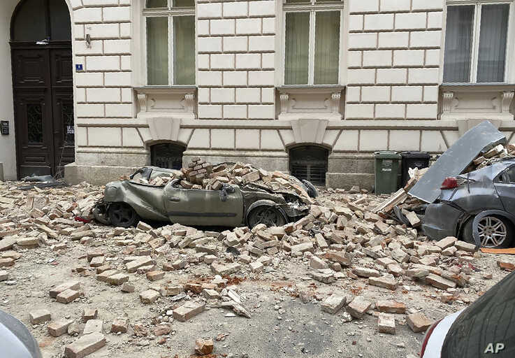 A car is crushed by falling debris after an earthquake in Zagreb, Croatia, Sunday, March 22, 2020. A strong earthquake shook…