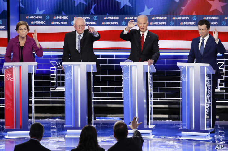 From left, Democratic presidential candidates, former New York City Mayor Michael Bloomberg, Sen. Elizabeth Warren, D-Mass.,…