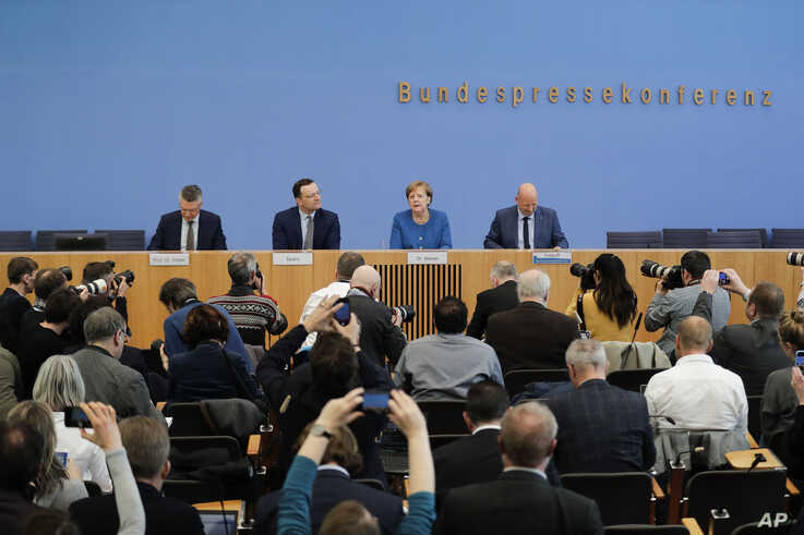 From right: the President of the Robert Koch Institute, German federal government agency and research institute responsible for…