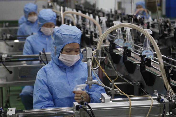 Workers of the Ryongaksan Soap Factory make disinfectant in Pyongyang, North Korea Thursday, March 19, 2020. North Korea has…