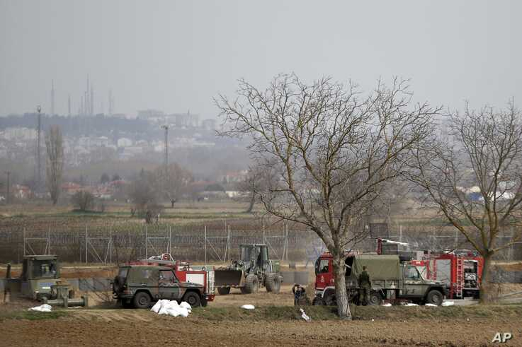 Greek army reinforces the border line at the Greek-Turkish border in the village of Kastanies, Evros region on Monday, March 9,…
