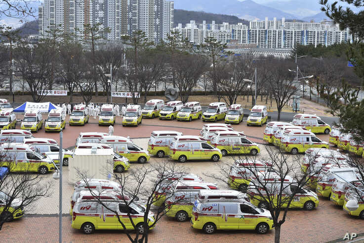 Ambulances are parked to transport patients with mild symptoms of the coronavirus in Daegu, South Korea, Tuesday, March 3, 2020…