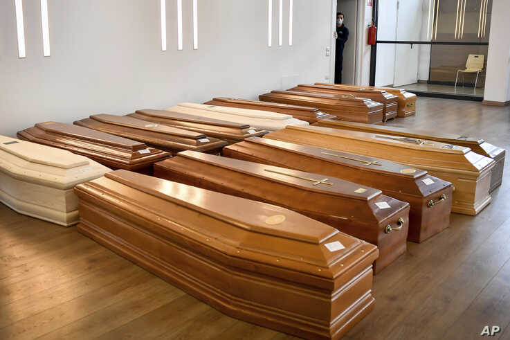 Coffins are lined up on the floor in the Crematorium Temple of Piacenza, Northern Italy, saturated with corpses awaiting…