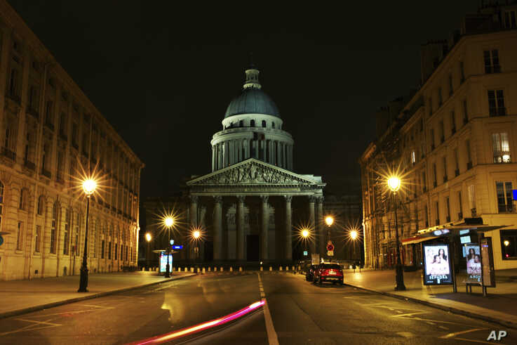 This long exposure photo shows an empty street near the Pantheon square, in Paris, Saturday, March 21, 2020. French President…
