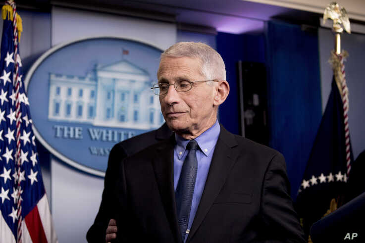 National Institute for Allergy and Infectious Diseases Director Dr. Anthony Fauci steps away from the podium during a news…